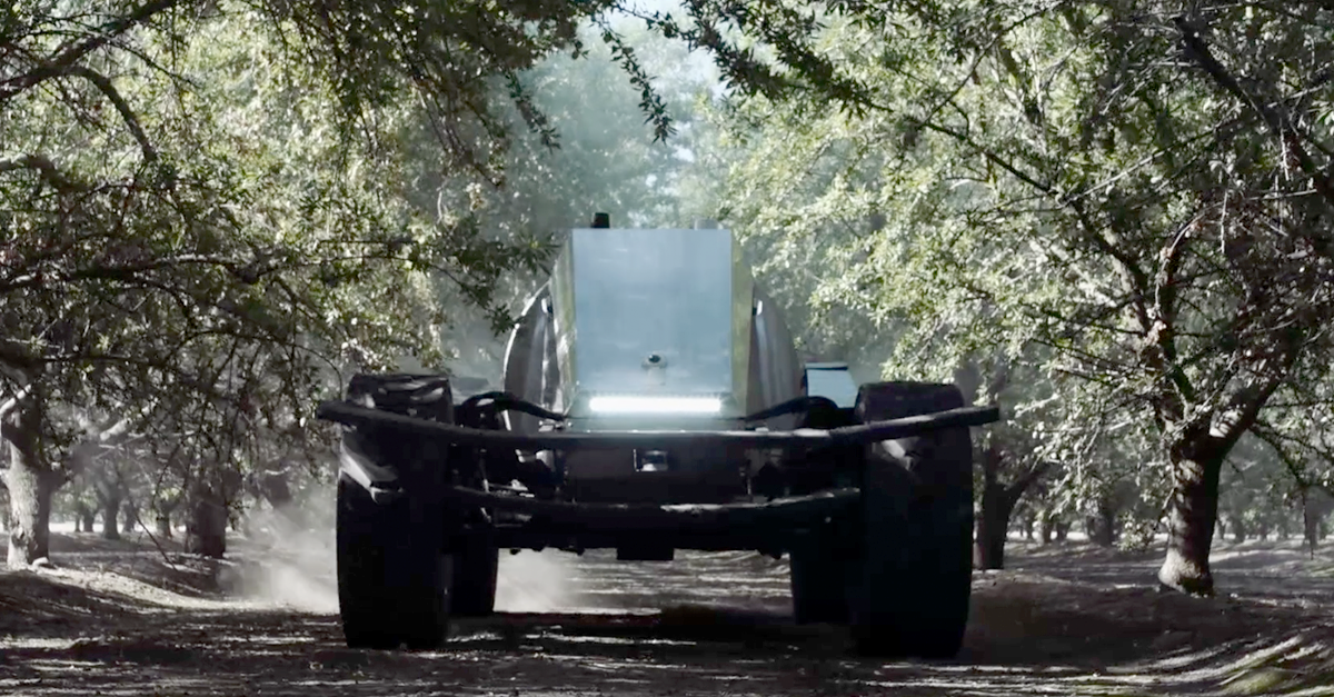 Is the Global Unmanned Spray System (GUSS) an autonomous vehicle or a robot?